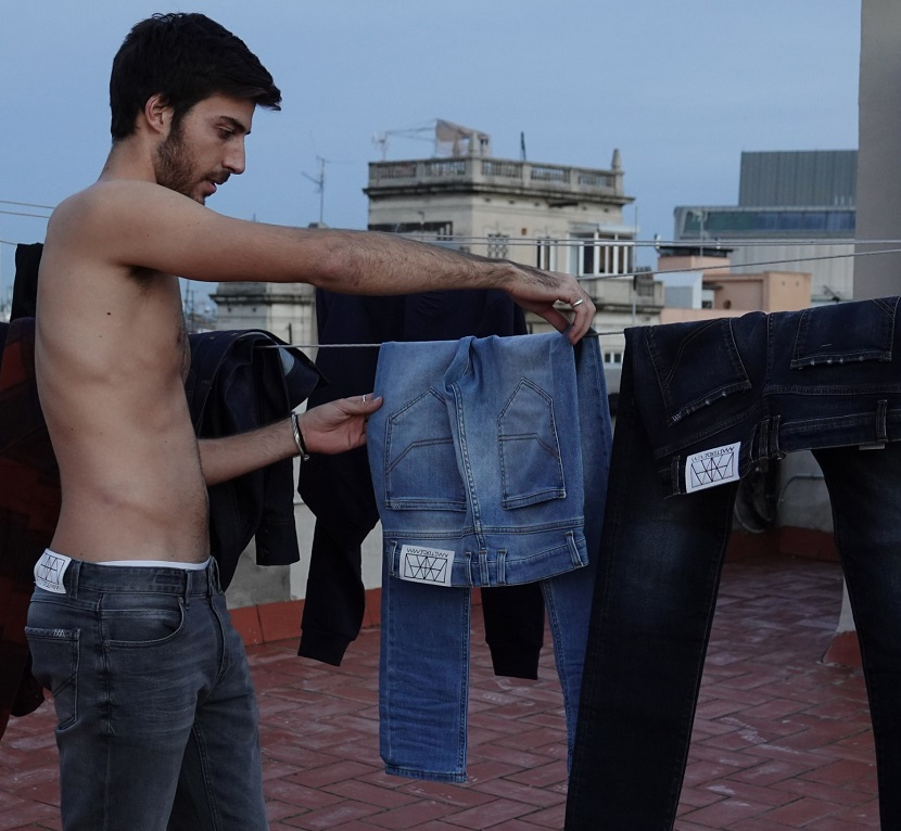 Wash your jeans less often and when you do, hang them to dry!